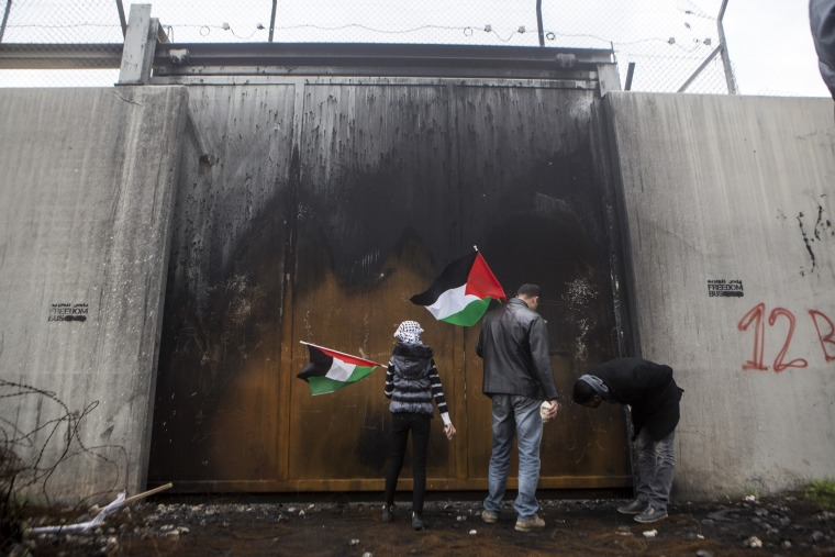 Protest against the wall, Bil'in, West Bank, 3.3.2017  Palestinians and some activists walk towards the Wall built on Palestinian lands during the weekly protest against the occupation in the West Bank village of Bil'in, March 3, 2017.